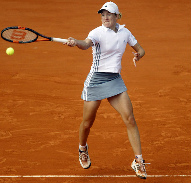 """Henin, seeded fourth at the 2003 French Open, won her first major title by rallying past then-No. 1 Serena Williams in a three-set semifinal and rolling over fellow Belgian Kim Clijsters in the semifinal. The first of Henin's four French championships was accompanied by controversy. Serena accused Henin of """"lying and fabricating"""" after Williams, leading 30-0, 4-2 in the third set, was unable to replay a serve even though Henin appeared to ask for time. Williams, perhaps rattled by jeers from the fans, lost the game and Henin ended up winning the set 7-5."""