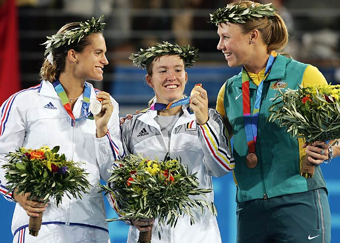 Henin began 2004 by winning her first and only Australian Open title, again beating Kim Clijsters in the final. But she then endured a four-month stretch in which she won only one match while dealing with a viral infection. That made her Olympic gold-medal-winning performance at the Athens Games that summer all the more impressive.
