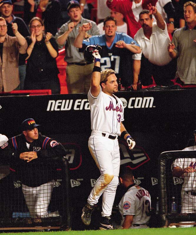 A crowd 41,235 at Shea Stadium witness the return of baseball to New York City for the first time since terrorist attacks of September 11. Mike Piazza's eighth inning home run gives the Mets a 3-2 dramatic victory over the Braves.