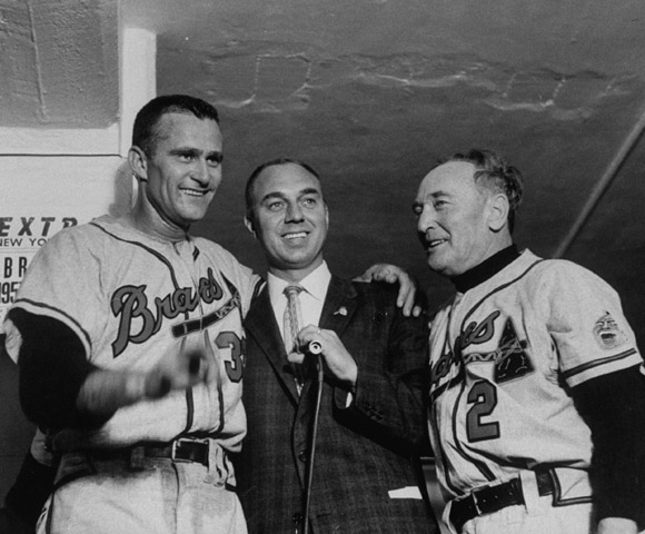 "Burdette (left) with Milwaukee Braves manager Fred Haney and a reporter, after the Braves beat the Yankees in the 1957 World Series. ""Lew Burdette happens to be one of my favorites. Not just because he beat the Yankees three times in the World Series, but because he was accused of a lot of things, they always said he threw spitballs, but nobody ever caught him. He could pitch in the clutch, was a pitcher's pitcher, and he didn't mind protecting his teammates. If a pitcher threw at one of our players, you just knew Lew was going to knock somebody else down."""
