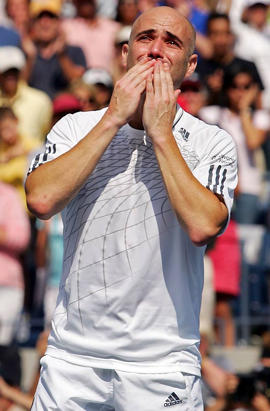 Andre Agassi blows kisses to the crowd after being defeated by Benjamin Becker at the U.S. Open. It was Agassi's final match before retirement.
