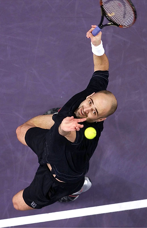 An aerial view of Andre Agassi during an opening round match of the Tennis Masters Cup in Sydney.