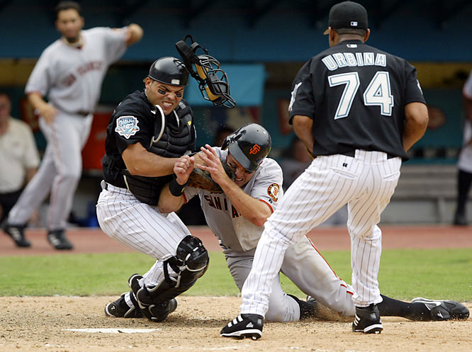 Ivan Rodriguez hung onto the ball as J.T. Snow barreled over him, marking the first time a postseason series ended with the potential tying run thrown out at the plate.