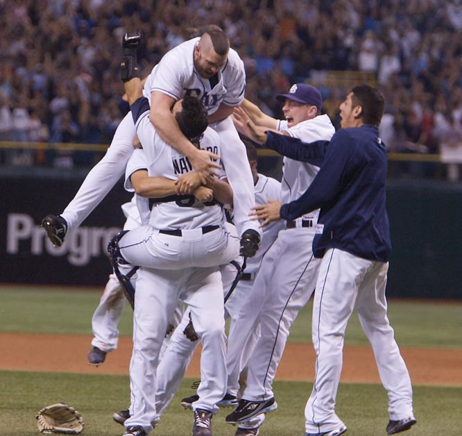 The hometown Rays beat the defending world champion Red Sox, 3-1, in the decisive Game 7 of the ALCS to win their first American League pennant.