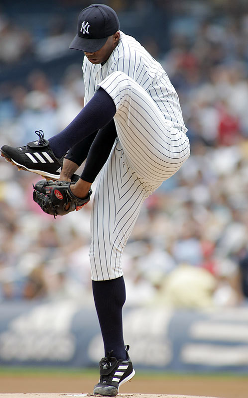 """""""El Duque,"""" the half-brother of Livan Hernandez, defected from Cuba on the day after Christmas in 1997. After accepting an offer of asylum in Costa Rica, Hernandez signed a four-year, $6.6 million deal with the Yankees. Over nine major league seasons with the Yankees, White Sox, Diamondbacks and Mets, El Duque compiled a 90-65 record and 4.13 ERA. But it was the playoffs where he really shined, as evidenced by his 9-3 record and 2.55 ERA in 19 postseason games. Hernandez has four World Series rings (three with the Yankees, one with the White Sox)."""