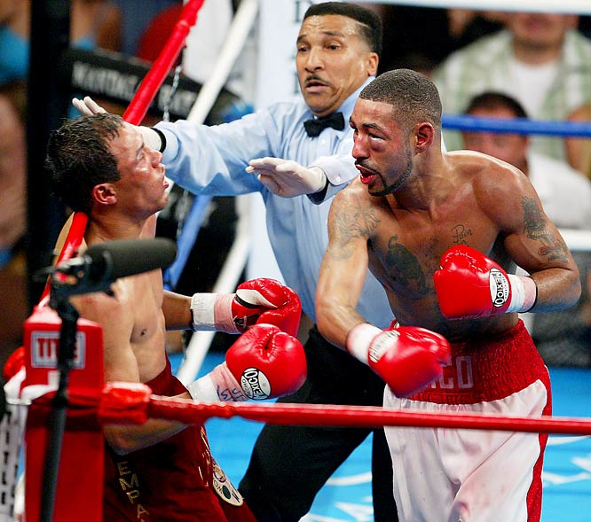 """For nine rounds, the action never flagged, the momentum swung back and forth and each man took tremendous punishment. Then came the 10th, and things got really amazing. Thirty seconds in, Castillo dropped Corrales with a crushing left hook. Amazingly, """"Chico"""" beat the count, gaining a few extra seconds to recover when his mouthpiece came out. Castillo jumped on him immediately and, 30 seconds later, Corrales was down again, badly hurt. But again, the mouthpiece came out and this time referee Tony Weeks deducted a point. It seemed academic as Castillo moved in for the finish, but Corrales, both eyes nearly swollen shut, fired back with a furious flurry, leaving Castillo hanging helpless on the ropes and forcing Weeks to end the fight with 54 seconds left in the round."""