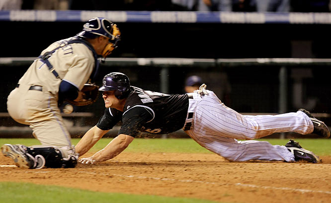 After the host Rockies took a 3-0 lead against pitching triple-crown winner Jake Peavy and the Padres countered with Adrian Gonzalez's grand slam, the game went into extra innings tied 6-6. Scott Hairston's two-run homer in the 13th off Jorge Julio, the ninth of 10 pitchers used by Colorado, looked like the final blow, but all-time saves leader Trevor Hoffman was greeted by a pair of doubles and Matt Holliday's game-tying triple. Holliday then tagged up on Jamie Carroll's fly to right, made a face-first dive at home plate and was called safe by Tim McClelland. Their 14th win in 15 games sent the Rockies to the playoffs and on their way to their first pennant.