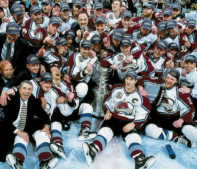 The Avs became the first team since the 1971 Canadiens to come back from a 3-2 series deficit and win the Cup, allowing veteran defenseman Ray Bourque to finally lift the chalice after 22 seasons. Young winger Alex Tanguay, 21, scored the first two goals, captain Joe Sakic added a third and playoff MVP Patrick Roy coolly held off the desperate Devils as Colorado dethroned the defending champions.