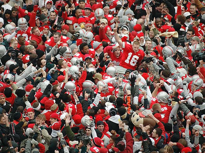 """""""This was a huge game in the Michigan-Ohio State rivalry since the Buckeyes were ranked second in the nation. Quarterback Craig Krenzel led a touchdown drive in the fourth quarter and the defense shut down the Wolverines to send the Buckeyes to the BCS national championship game. I was shooting from overhead and, as the fans swarmed the field, I was able to get this shot of Krenzel being picked up."""""""