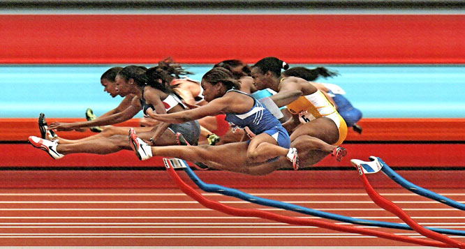 """""""The grace of movement of the hurdles, and the Penn Relays presented a wonderful place to use a special strip camera, and  to show the grace and beauty of the hurdles competition.  It's a difficult moment to get just right, and the hurdlers made it perfect by crossing in unison."""""""