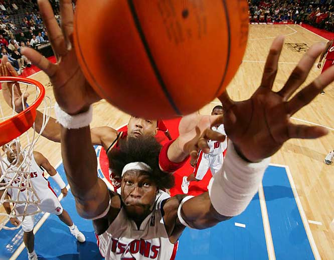 """""""I love the giant hands. With this angle, he's coming right at the camera. I also love Ben Wallace's hair, which is so big that the defender is reaching through it for the ball."""""""