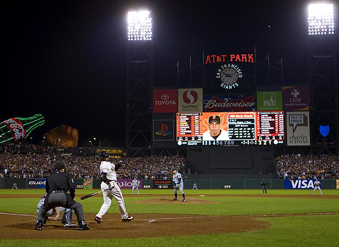 """""""Besides photographing Barry Bonds from the outfield as he hit career home run 756 to break Hank Aaron's record, I wanted a special image from behind home plate that would show the entire stadium and the scoreboard with the ball soaring through the night sky. A picture like this tells a story and gives a historical perspective showing off the ballpark where the record was broken. In order to get a picture like this, I had to get the the ballpark six hours early to set up this remote camera. Thanks to our great assistant Kojo Kinno, my remote fired and I got the picture I wanted. This photograph, combined with the picture I shot with my handheld camera from the outfield, tells the story of this historical night."""""""