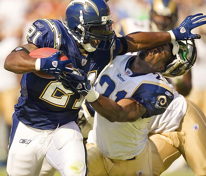 """""""I  love this photo. I took it with a telephoto lens. Chargers running back LaDainian Tomlinson came around the corner, and he has such explosive upper-body power. He used a straight-arm to shed his defender and literally knocked the guy's helmet off."""""""