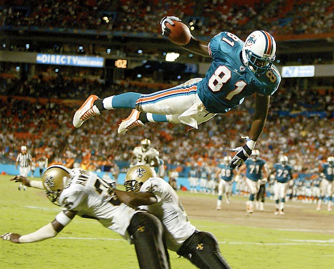 """As part of SI.com's decade project, several Sports Illustrated photographers have selected a handful of their favorite shots from the 2000s and described what makes these pictures special.""""This shot of Dolphins tight end Randy McMichael diving over Saints defenders for a touchdown was made during a preseason game in Miami. I had seen McMichael do something slightly similar the previous week in Tampa, which I was not prepared for. So I anticipated his movement this time, and having the right lens and camera combination allowed me to make this picture. I never imagined his leap would be this spectacular."""""""
