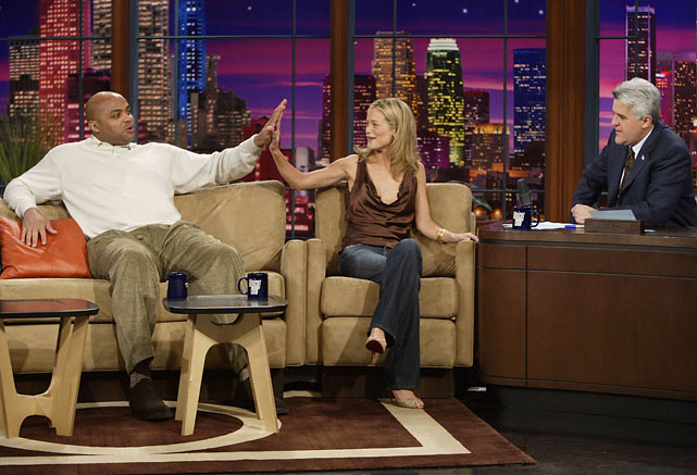SI swimsuit cover model Carolyn Murphy compares hand sizes with Charles Barkley during a February 2005 appearance.