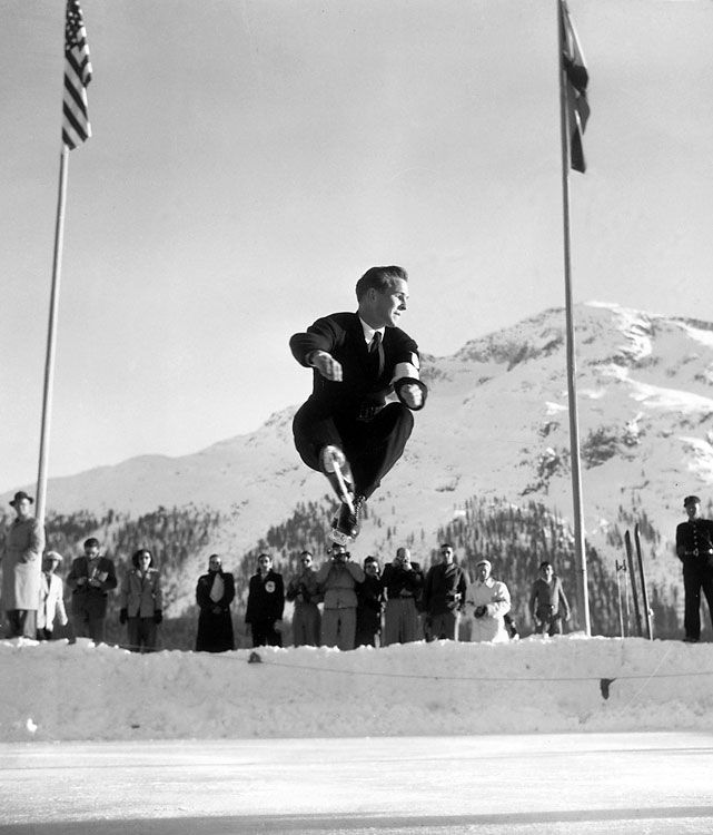 Button revolutionized his sport while becoming the first American figure skater to win gold. Dazzling fans and judges, he fearlessly introduced the double axel to Olympic competition only two days after successfully completing one for the first time. Button later won a second gold in 1952 at the Oslo Games, this time introducing the triple loop. Out of the 18 total judges at those two Games, only one did not award him a first-place vote.