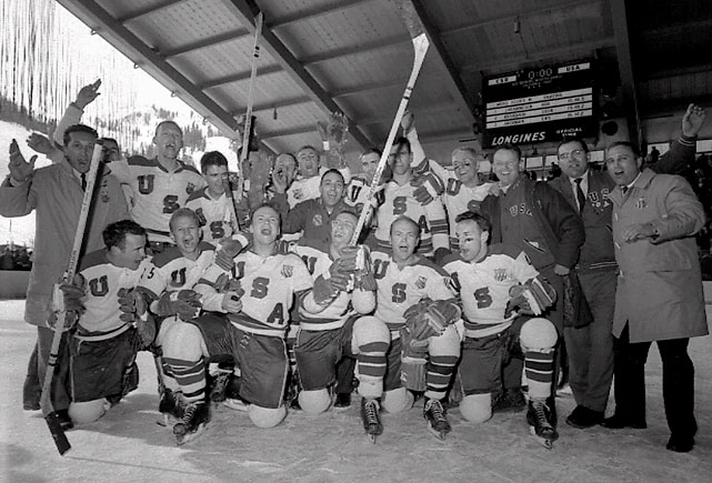 """Often called """"the forgotten miracle,"""" the U.S. upset vastly superior Canadian and Soviet teams. Their 3-2 win over the Soviets came with a Cold War backdrop, and their 9-4 rout of Czechoslovakia secured the gold. The U.S. got terrific goaltending from Jack McCartan. In what would be a link to a future Lake Placid miracle: Bill and Roger Christian, the father and uncle respectively of 1980 team defenseman Dave Christian, produced the tying and winning goals against the Soviets. The last player cut from the team before the Games: Herb Brooks, who would coach the 1980 squad."""