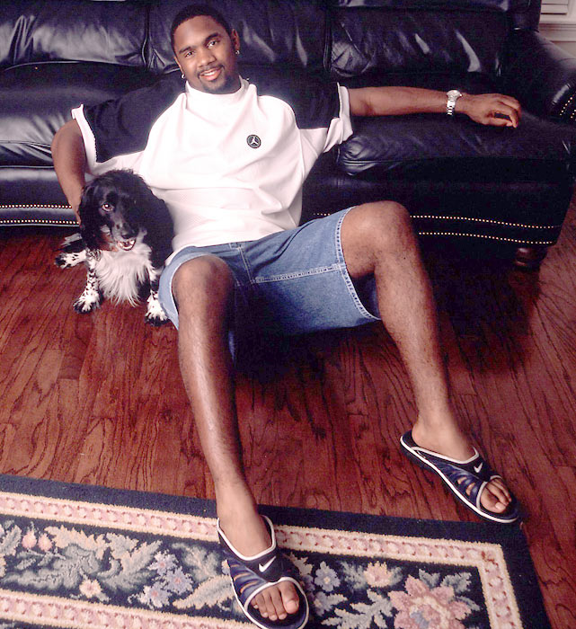 Charles Woodson and his dog enjoy a leisurely afternoon at Woodson's house in Oakland.