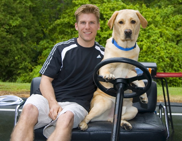Jamie McMurray poses with his dog, Jake, at the Richmond International Raceway.