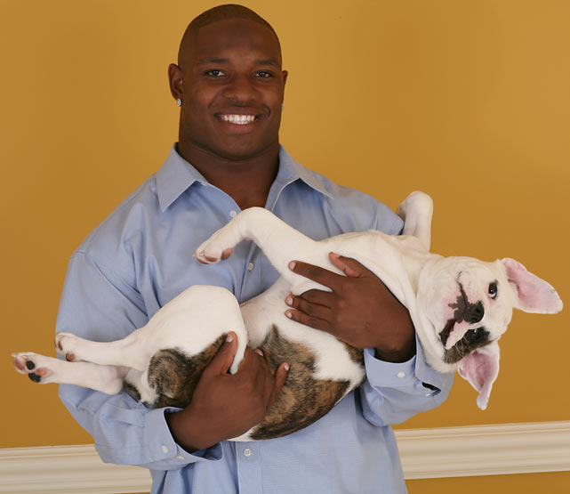 Maurice Jones-Drew and his dog Phillip strike a pose during an SI photo shoot.