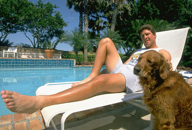 Dan Marino and his dog enjoy some time by the pool.