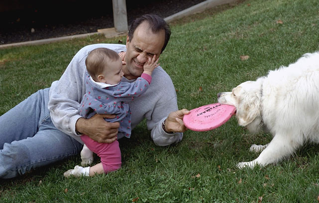 Joe Torre plays in his backyard  with his 11-month-old daughter Andrea and the family dog.