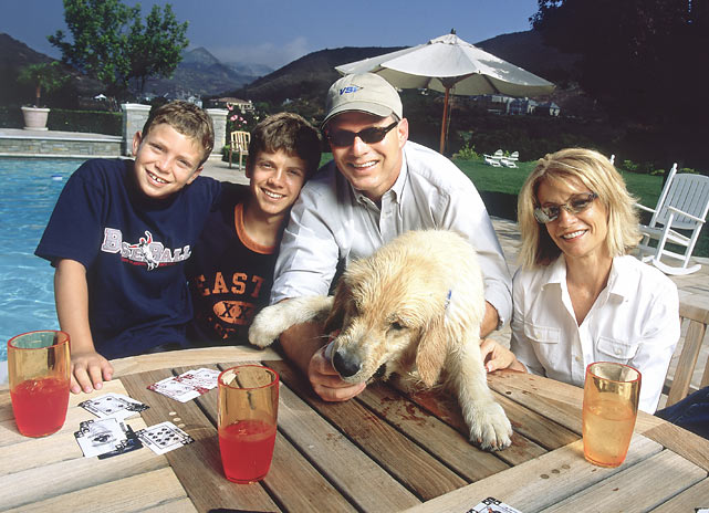 Lenny Dykstra, his wife and their two sons hang out in the family's backyard while the family dog tries to stay out of mischief.