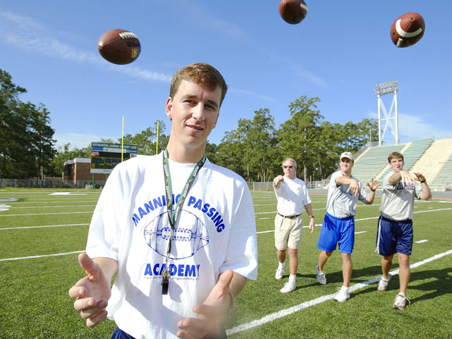 Archie, Peyton and Eli hurl footballs at Cooper during a light moment at the Manning Passing Academy.