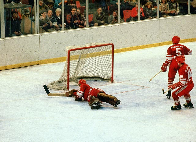 Soviet defensemen Vasilij Pervuchin and Zinetula Biljaletdinov hadn't noticed Mark Johnson move in for the rebound as they watched the clock tick off the last few seconds. Johnson fired the puck past a diving Tretiak to tie the score 2-2 with one second left in the period.  Soviet coach Viktor Tikhonov replaced Tretiak with backup goaltender Vladimir Myshkin for the start of the second period, a move which shocked players on both teams.