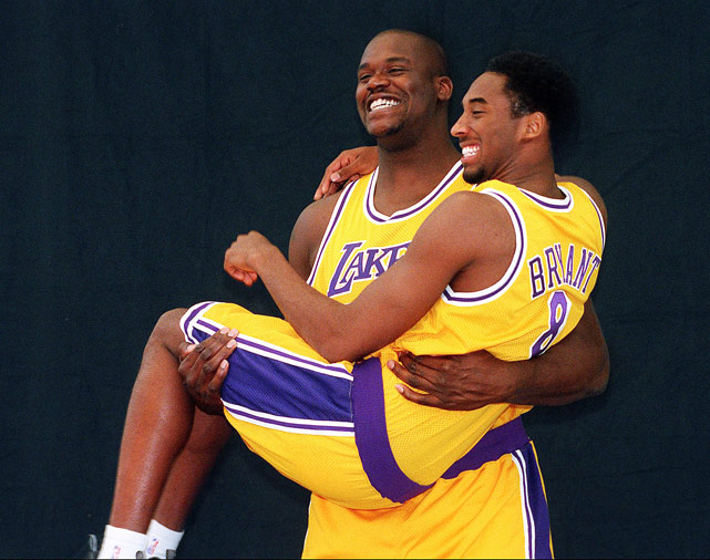 Lakers' center Shaquille O'Neal carries Bryant during a team media day photo shoot. Aww, they look so happy!
