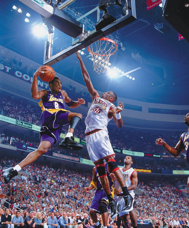 En route to winning his second championship, Kobe goes up for a shot against the Sixers' Dikembe Mutombo in Game 4 of the 2001 Finals.