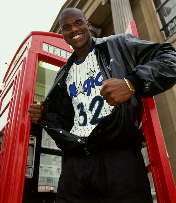 Shaquille O'Neal poses for a portrait in front of a telephone booth during the 1993 Dream Team tour of London.