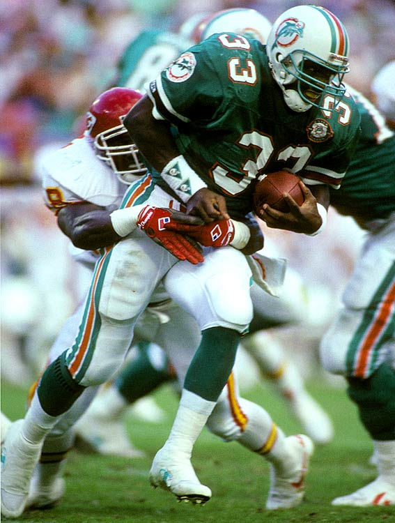 """The Dolphins finally thought they'd solved their running-back woes with this big, powerful runner from Florida State. In three seasons with Miami, Smith never averaged more than 3.7 yards per carry and was a fumbling machine with a knack for coughing the ball up at the worst times. He basically was driven out of town by a chorus of """"Sammie sucks,"""" before moving on to Denver, where he lasted just three games."""