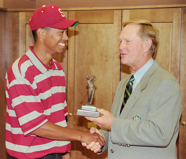Woods shakes hands with Jack Nicklaus after receiving the 'Jack Nicklaus College Player of the Year' award in June 1996.