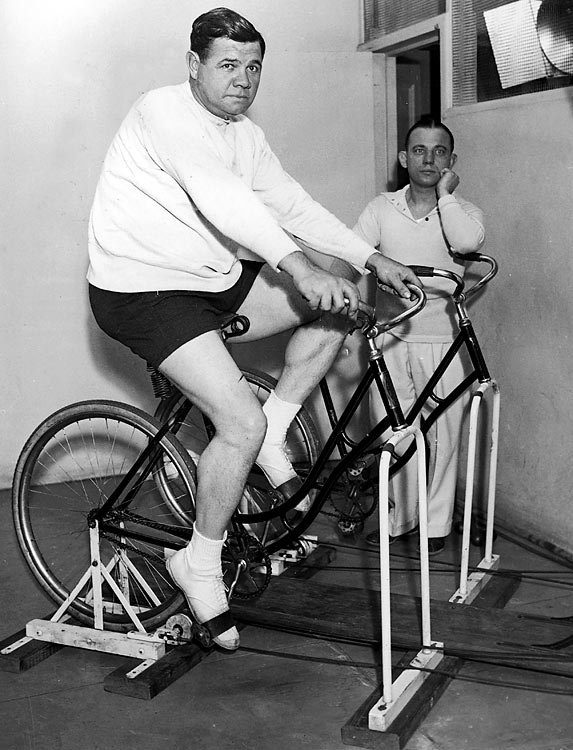 In honor of National Bike To Work Week, from May 17 to 21, here are a few shots of sports figures and their pedal-powered machines.Baseball legend Ruth rides a stationary bike while former boxer and gym owner Arthur McGovern looks on.