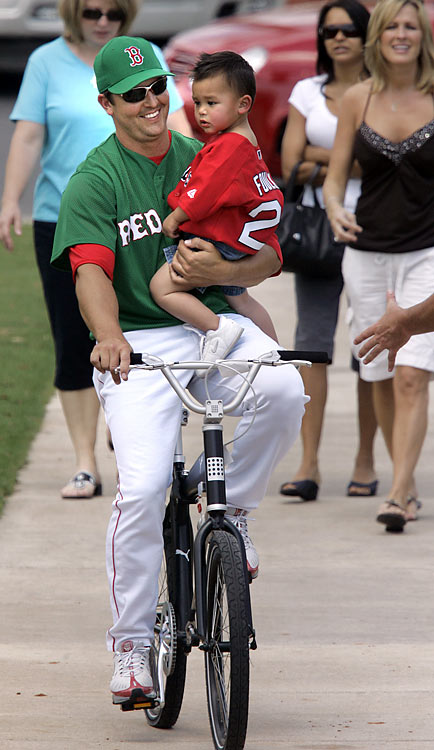 Foulke, then a Red Sox pitcher, takes his 2-year-old son Kade for a ride prior to a spring training game against the Marlins in Fort Myers, Fla.