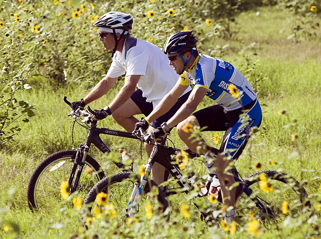 President Bush and Armstrong, a seven-time winner of the Tour de France, take a ride through the president's property in Crawford, Texas.