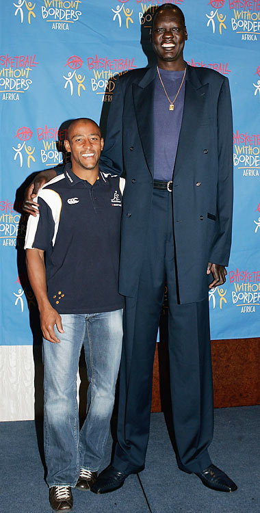 Bol poses with Wallaby captain George Gregan during a tour of  South Africa to promote basketball in the region.