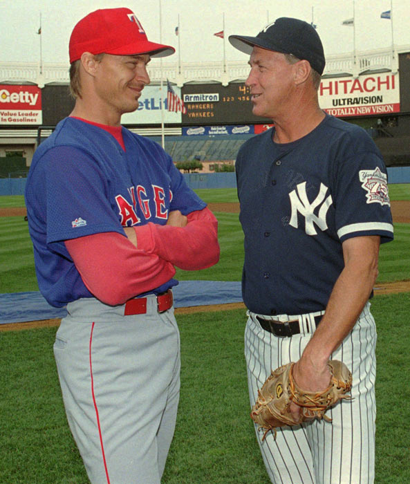 Todd and Mel Stottlemyre become the first father and son to win 100 baseball games.