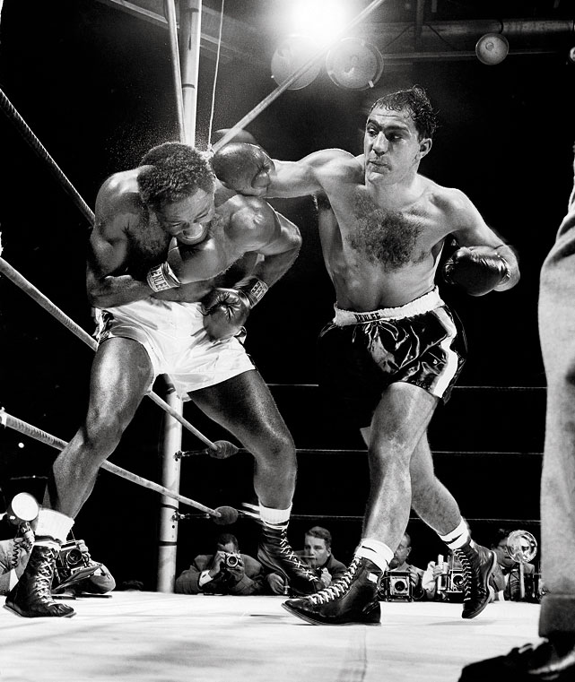 The first of two clashes between Marciano and Charles -- the current and former heavyweight champions, respectively -- took place between 47,585 fans at Yankee Stadium. Marciano suffered a gruesome cut in the fourth round but still came away with the unanimous decision.