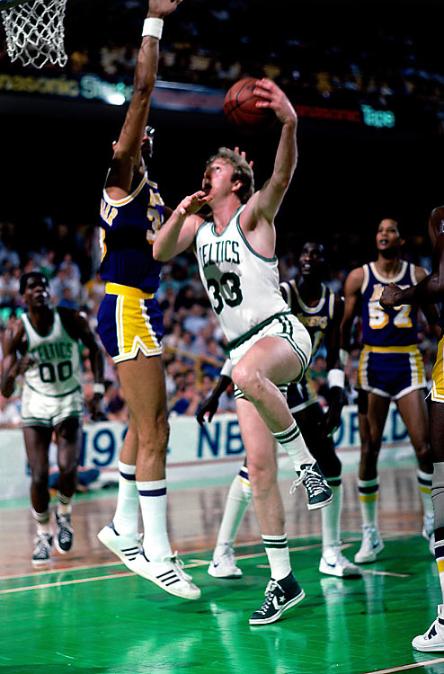 After L.A. made the NBA Finals in consecutive seasons while the Celtics sat at home, Boston was determined to re-ignite the legendary rivalry on the game's biggest stage. The Celtics met the Lakers in the 1984 NBA Finals in a series that featured eight future Hall of Famers and seven epic games. Magic Johnson averaged 18 points and 14 assists per game in the Finals, while regular season MVP Larry Bird led the Celtics with 27 points and 14 rebounds per game. Game 7 in Boston was the climax of an all-out war of a series. Boston held a 13-point advantage heading into the fourth quarter, but the Lakers closed to within three with just over a minute to play. The C's resisted, though, and came out on top with a 111-102 win at home, led by 24 points from Cedric Maxwell.
