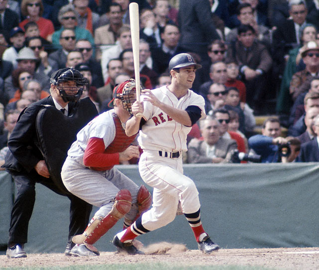 """After hovering around .500 for a few months and losing young star Tony Conigliaro to a beanball, Boston made a legendary run at season's end. Four teams sat within a half-game of the AL pennant with a month to go, and on the last day of the season, the Red Sox faced the Twins, both teams battling the Tigers for the AL crown. The Sox beat Minnesota at Fenway during the day, and then huddled around a radio to hear the Tigers lose, giving Boston the AL pennant in the season deemed """"The Impossible Dream."""""""