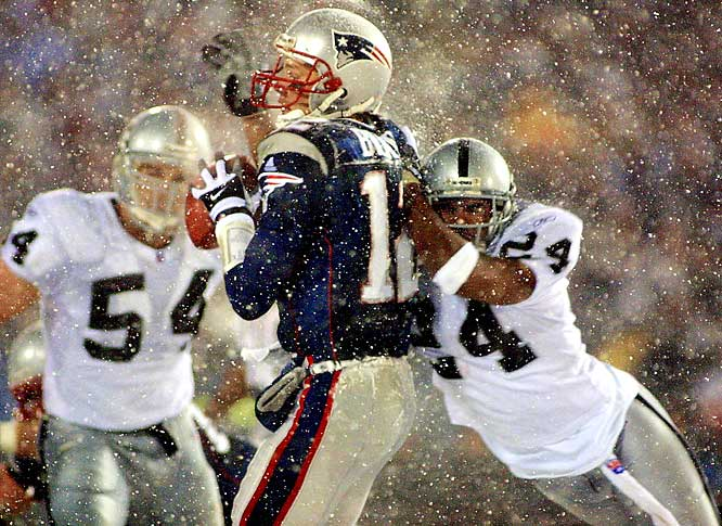 """Tom Brady got the Patriots' dynasty started with one controversial play near the end of a 2002 NFL divisional playoff game between the Patriots and Raiders. Brady dropped back to pass, and just as he began his throwing motion, had the ball knocked out of his hands, seemingly a fumble that gave the Raiders the victory. But officials reviewed the play and ruled that Brady brought the ball to his body as part of his throwing motion, thus coining the """"tuck rule"""" and igniting a league-wide debate."""