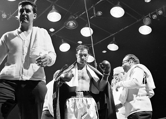 Rocky Marciano retired undefeated, but didn't win the world heavyweight title until 1952, when he knocked out Jersey Joe Walcott in the 13th round of a dogfight in Philadelphia. A year later, the two squared off in Chicago, with Marciano looking to defend his heavyweight title, the first of six title defense fights. He didn't need long as he knocked out Walcott just 2:25 into the first round on May 15, 1953.