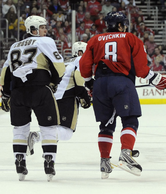 Crosby, 22, and Ovechkin, 24, both appear on course to set several NHL records. But on the ice, they share nothing... save for a frigid relationship and similar statistics. So what might give Crosby the edge in this rivalry? He's hoisted the Stanley Cup over his head, AND stood on an Olympic medal podium with gold around his neck.