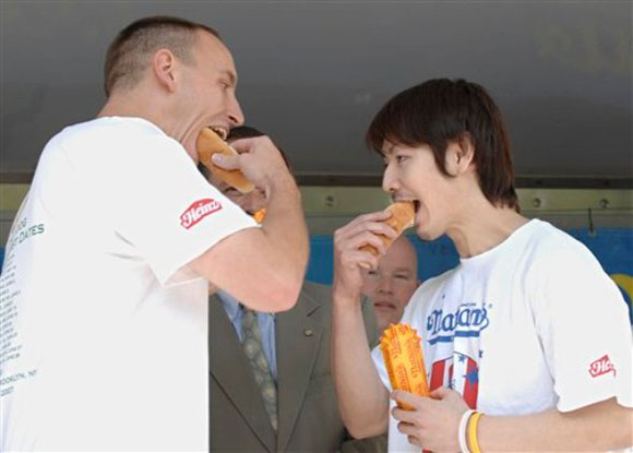It took 66 hot dogs for this rivalry to take off. In 2007 Kobayashi, the six-time defending champion of Nathan's Hot Dog Eating Contest, lost to Chestnut, who beat him by consuming 66 hot dogs in twelve minutes. Ever since, the two have been the top competitors in the delicious world of competitive eating. They probably get a stomach ache every time they meet, but is it because of competitive nerves... or just too much food?