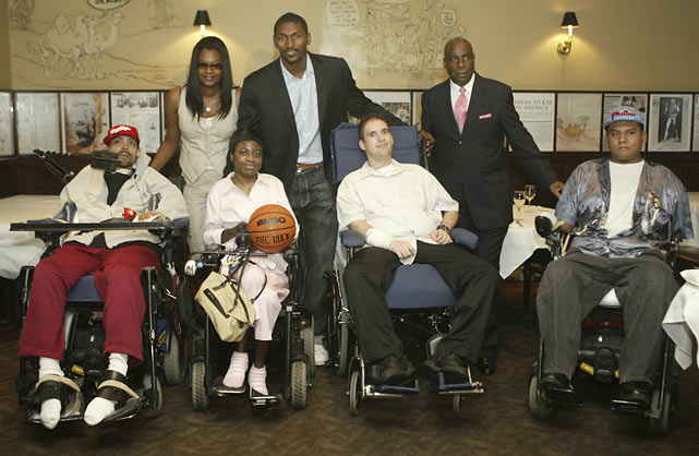 Artest stands with his wife, Kimsha, and Henry Carter, Chairman and CEO of Wheelchair Charities, and several kids during a news conference for the All-Star Classic for Wheelchair Charities at Madison Square Garden.