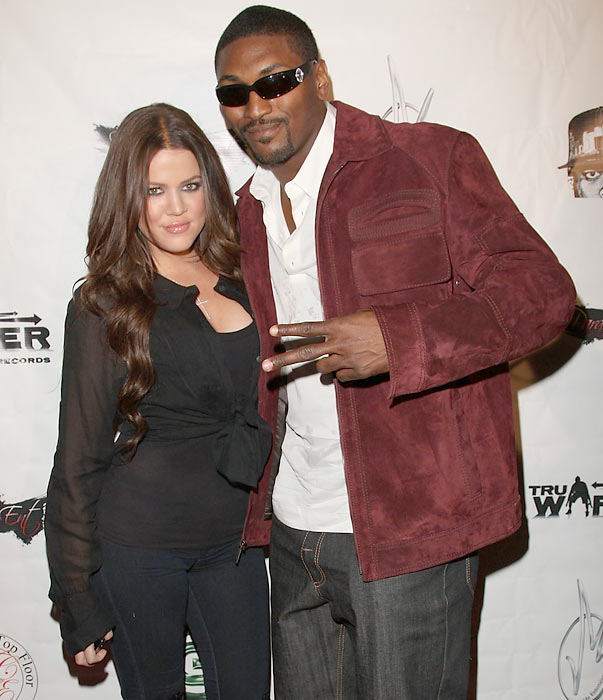 """Khloe Kardashian and Ron Artest strike a pose at Artest's Welcome to LA"""" party. Kardashian is now married to Lakers forward Lamar Odom."""
