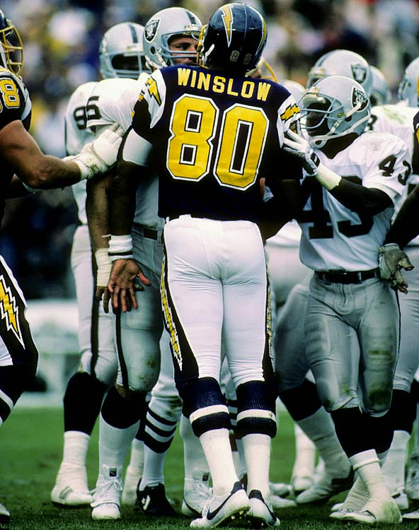 Raiders defensive end Howie Long and Chargers tight end Kellen Winslow exchange pleasantries during the Chargers' 40-34 overtime win.