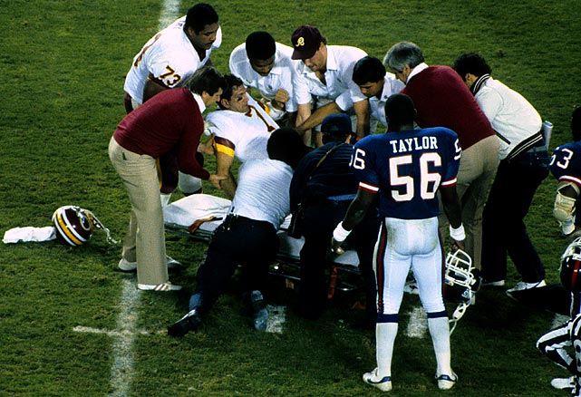 In one of the most gruesome injuries in the violent history of the NFL, Joe Theismann's career came to an end when Giants' linebacker Lawrence Taylor snapped Theismann's leg. The injury was so bad that the fearsome Taylor, who made a living from his desire to pummel quarterbacks, immediately ran towards the Redskins sideline yelling for help.